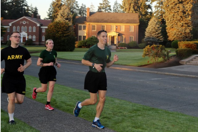 Sgt. William Ezzard, center, leads a training run with Specialists Nicholas Brown and Emma Larson on Joint Base Lewis-McChord. Ezzard, a paralegal NCO with 42nd Military Police Brigade, is one of three brigade Soldiers who will represent Joint Base Lewis-McChord at the Army Ten Miler race in Washington, D.C.