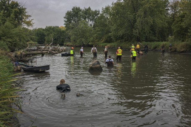Immediately following the river reroute, staff from the Corps of Engineers and Minnesota Department of Natural Resources begin relocating mussels impacted by the river restoration.