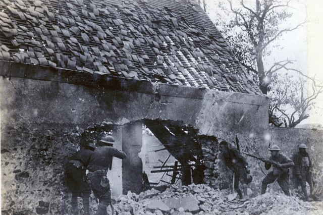 "National Guard Soldiers of the 166th Infantry (formerly the 4th Regiment, Ohio National Guard) move forward with weapons at the ready during an attack in the autumn of 1918. The 166th Infantry fought as part of the 42nd ""Rainbow"" Division during St. Mihiel in September and Meuse-Argonne in October, part of the American Expeditionary Force 100 days offensive that brought an end to World War I."