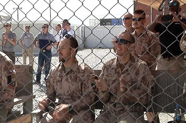 Attendees at the K9 competition give their approval for the dogs' performance at Bagram Airfield, Afghanistan. (Video image by Jon Micheal Connor, Army Public Affairs)