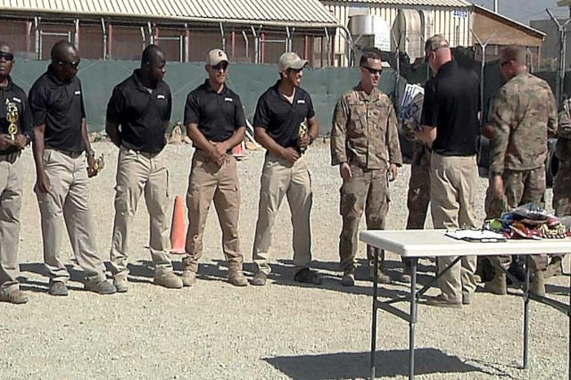 Dog handlers receive trophies and certificates following the completion of the K9 competition at Bagram Airfield, Afghanistan. The competition served to build morale, sharpen the dogs' skills, and enable better dog teams. (Video image by Jon Micheal Connor, Army Public Affairs)