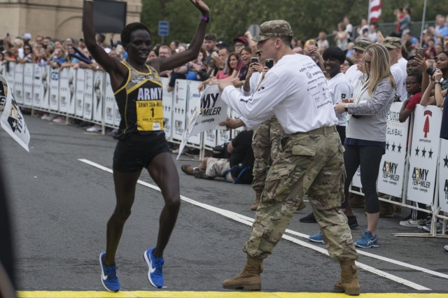 Spc. Susan Tanui crosses the finish line to become the first-place female finisher for the second straight year in the Army Ten-Miler, Oct. 7, 2018. Tanui finished 56:33, 17 seconds better than her 2017 time.