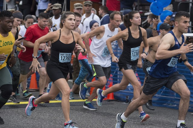 A wave of runners begins the annual Army Ten-Miler in Washington, D.C., Oct. 7, 2018. About 35,000 runners registered to run the course, which begins in the Pentagon and winds through the streets of the nation's capital. The race is the third-largest 10-mile race in the world.