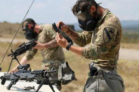 Soldiers assigned to 1st Armored Brigade Combat Team, 1st Cavalry Division, assembles an M9 handgun during the weapon skills lane of a spur ride, Novo Selo Training Area,  Bulgaria, Sept. 7, 2018. The spur ride is a time-honored cavalry tradition that gives cavalry troops the opportunity to earn silver spurs by participating in a series of physical and mental challenges, which helps create camaraderie and esprit de corps.