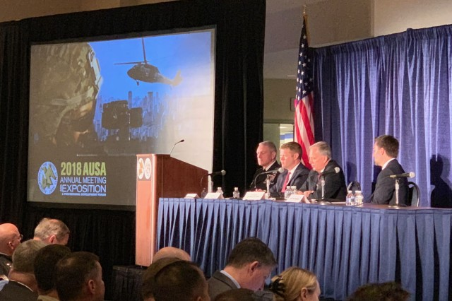 "(L to R) GEN Mike Murray, Commanding General of Army Futures Command, HON Ryan McCarthy, Undersecretary of the Army, Dr. Bruce Jette, Assistant Secretary of the Army for Acquisition, Logistics & Technology, and Mr. Trae Stephens, Venture Capitalist, lead the first CMF Panel ""Army Futures Command Unifies Force Modernization"" at AUSA 2018 in the Walter E. Washington Convention Center in Washington, DC Oct. 8, 2018."