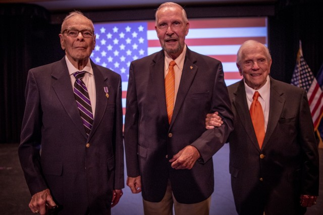 Retired U.S. Army Col. Ben Skardon, 101, (right) a survivor of the Bataan Death March and 1,255 days as a prisoner of war, Army 1st Lt. William Funchess, 90, (left) a survivor of 1,038 days as a POW in the Korean War, and Air Force Col. Bill Austin, 80, (center), a F-4 Phantom pilot who was shot down on his 81st mission over Vietnam and survived 1,986 days as a POW, chat during a POW/MIA recognition ceremony at Clemson University, Oct. 4, 2018.