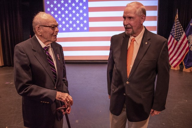 U.S. Army 1st Lt. William Funchess, 90, (left) a survivor of 1,038 days as a POW in the Korean War, and Air Force Col. Bill Austin, 80, a F-4 Phantom pilot who was shot down on his 81st mission over Vietnam and survived 1,986 days as a POW, chat before a POW/MIA recognition ceremony at Clemson University, Oct. 4, 2018.