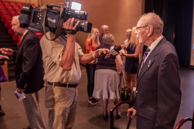 Former Army 1st Lt. William Funchess, 90, a survivor of 1,038 days as a POW in the Korean War, talks to a reporter after a POW/MIA recognition ceremony at Clemson University, Oct. 4, 2018.