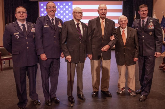 Retired U.S. Army Col. Ben Skardon, 101, (second from right), a survivor of the Bataan Death March and 1,255 days as a prisoner of war, Army 1st Lt. William Funchess, 90, (third from left) a survivor of 1,038 days as a POW in the Korean War, and Air Force Col. Bill Austin, 80, (third from right) a F-4 Phantom pilot who was shot down on his 81st mission over Vietnam and survived 1,986 days as a POW, pose with members of Clemson's Air Force ROTC and the Department of Defense Joint Personnel Recovery Agency (JPRA) before a POW/MIA recognition ceremony at Clemson University, Oct. 4, 2018.