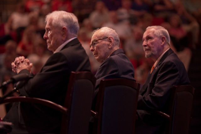 Three former prisoners of war (from left), Army Col. Ben Skardon, 101 (WWII), Army 1st Lt. Bill Funchess, 90 (Korea), and Air Force Col. Bill Austin, 80 (Vietnam) listen to a speech during a POW/MIA recognition ceremony at Clemson University, Oct. 4, 2018.