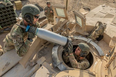 Armor crewmen assigned to 4th Stryker Brigade Combat Team, 2nd Infantry Division, load Sabot rounds onto a M1 Abram Tank during a pre-deployment training exercise at Fort Hood, Texas, Aug. 18. Sabot rounds work like a basic arrow by penetrating armor with momentum of force rather than explosive power.