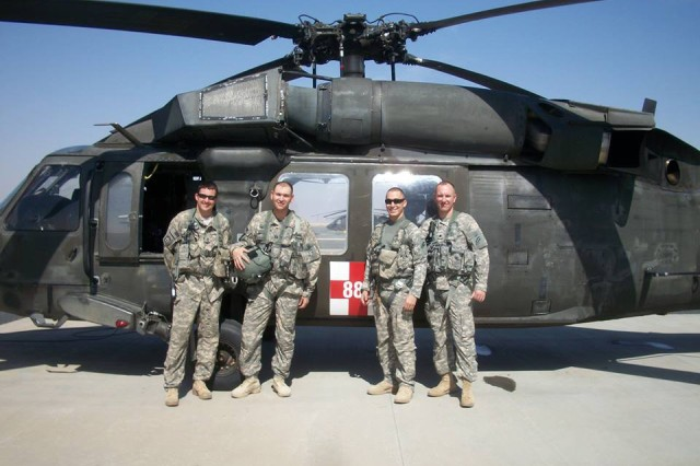 New York Army National Guard Maj. Stephen Carson, second from left, is seen with his aeromedical flight crew at Udairi Airfield after a mission during his deployment to Kuwait in 2013-14. Carson, then a captain, served as a Physician's Assistant support of the New York Army National Guard's 642nd Support Battalion, part of the 42nd Combat Aviation Brigade. Carson worked in the Aviation Medicine Clinic and unit aid station as well as flying with the Air Ambulance Company during medical evacuations missions and training across the theater. From left, Staff Sgt. Michael Ball, Carson, Capt. Brandon Reynolds, and Col. Jack James.