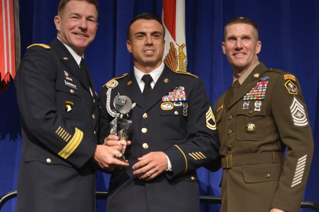 Sgt. 1st Class Sean Acosta accepts the NCO of the Year award Oct. 8, 2018.