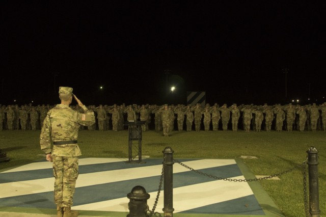 Maj. Gen. Lee Quintas, 3rd Infantry Division Commanding General, and Soldiers assigned to the 1st Armored Brigade Combat Team, 3ID, salute the flag during a homecoming ceremony at Cottrell Field, Fort Stewart, Ga., Oct. 2, 2018. While in South Korea, training continued at all levels including qualifying all tank and bradley crews. (U.S. Army photo by Spc. Jason Greaves/Released)