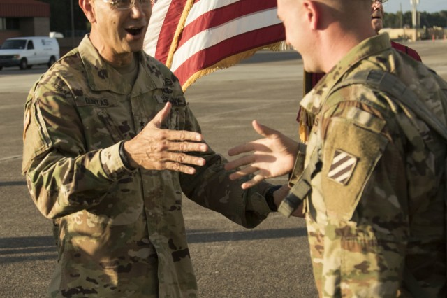 Maj. Gen. Lee Quintas, 3rd Infantry Division commanding general welcomes home a Soldier from the 1st Armored Brigade Combat Team, 3ID, at Hunter Army Airfield, Ga., Oct. 2, 2018. This rotation to South Korea marks the first time since the Korean War that a 3ID unit deployed to Korea. (U.S. Army photo by Spc. Jason Greaves/Released)