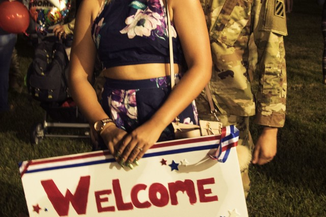 Cianna Warren, a military spouse, welcomes home her husband, Spc. Warren Bailey, Company A, 2nd Battalion, 7th Infantry Regiment, 1st Armored Brigade Combat Team, 3rd Infantry Division, at Cottrell Field, Fort Stewart, Ga., October 2, 2018.  (U.S. Army photo by Spc. Jason Greaves/Released)