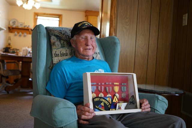 Former U.S. Army Soldier Dale Jones poses with the medals he received during his service with the 1st Armored Division during World War II.