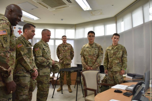Soldiers at CTF-Defender brief The 94th Army Air and Missile Defense command team, Brig. Gen. Michael Morrissey and Command Sgt. Maj. Eric McCray, on the new telemedicine program for Soldier care that has been set up at the site.