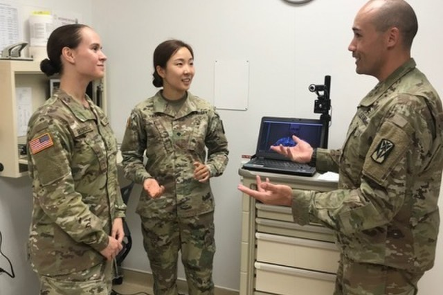 Capt. Vanderburg leads a telemedicine training session with medics Spc. Kyoung Yeon, Pfc. Madelyn Blundell and Spc. Wesley Gathercole on the telemedicine computer system.