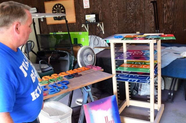 Bagley's latest addition to the sign making process is a drying rack, donated by a friend, which can dry as many as 25 signs, cutting down on the amount of space needed.