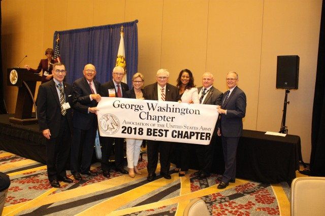 AUSA 2nd Region President Douglas Gibbens (2nd from left) and Dr. Bruce Jette, Assistant Secretary of the Army for Acquisition, Logistics & Technology (ASA(ALT)) present the 2018 Best Chapter Award to the George Washington Chapter during the 2nd Region Breakfast Oct. 10, 2018 in Washington, DC.