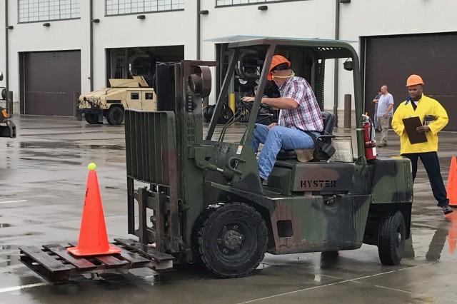 A forklift driver maneuvers during a forklift skills test at Fort Leonard Wood