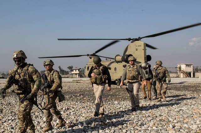Afghan National Police advisers from the Train, Advise, Assist Command-East exit a CH-47 Chinook after arriving at one of their advising locations.