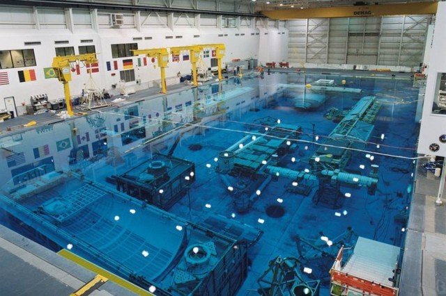The Neutral Buoyancy Laboratory is an astronaut training facility featuring a large indoor pool of water in which astronauts may perform simulated EVA tasks in preparation for upcoming missions. Trainees wear suits designed to provide neutral buoyancy to simulate the microgravity they would experience during spaceflight.