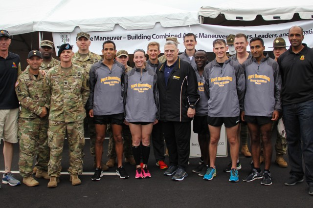 Army Chief of Staff Gen. Mark Milley, Maneuver Center of Excellence Commanding General Maj. Gen. Gary Brito and U.S. Army Armor School Commandant Brig. Gen. David Lesperance pose with the Fort Benning MCoE running team before the Army Ten-Miler, Washington D.C.