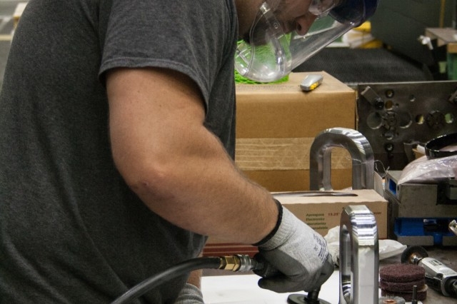 Marc Blieu, Rock Island Arsenal-Joint Manufacturing and Technology Center machinist, completes a bomb hangers for Blue Grass Army Depot. RIA-JMTC manufactures a production aid for Blue Grass Army Depot. Due to availability of materials, RIA-JMTC was able to produce bomb hangers for the Depot in 21 days. The process of making the hangers is just under three hours using two machining centers. (Photo by Debralee Best, RIA-JMTC)