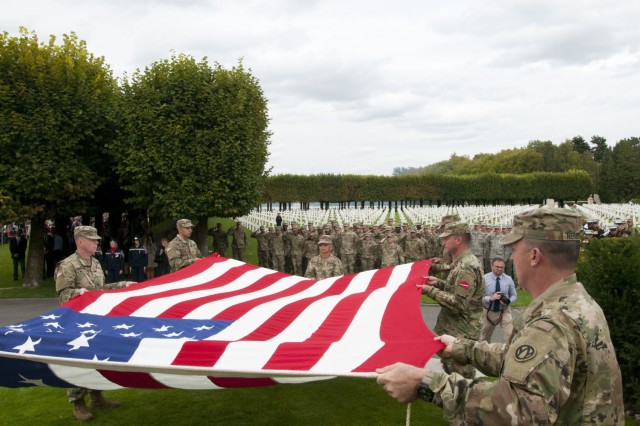 U.S. Army Reserve Soldiers participate in a Flag Retirement Ceremony during the WWI Centennial Commemoration at the Saint-Mihiel American Military Cemetery located in Thiaucourt, France, Sept. 22, 2018.