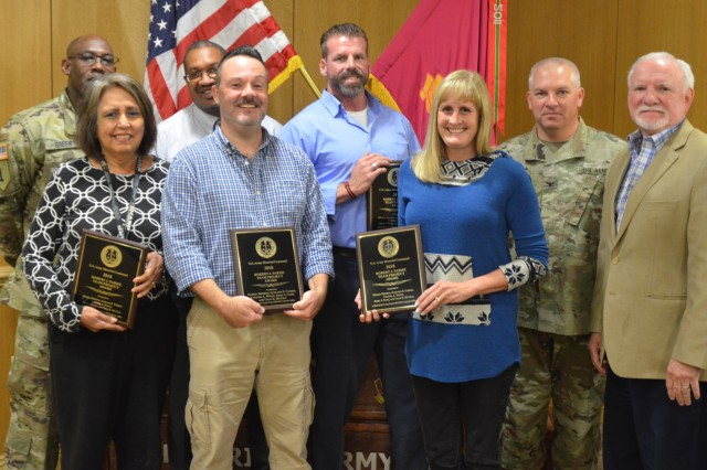 Members of the RRAD Legal Counsel were recognized as recipients of the Army Materiel Command 2018 Robert J. Parise Team Project Award. Pictured from left front are: Gloria Briseno, Jerry Nash, Cynthia White and RRAD Deputy Commander Patton Tidwell. Back row: RRAD SGM Keith E. Green, RRAD Chief Counsel Garland Yarber, Chad McCrary and RRAD Commander COL Stephen M. York.