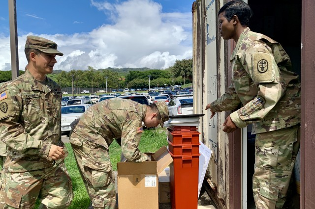 Tripler Army Medical Center's Public Health Nursing Officer in Charge Capt. Everline Atandi, right, distributes influenza supplies at TAMC on Oct. 11, 2018, to U.S. Army Pacific Headquarters Headquarters Command Battalion medics in preparation of a seasonal flu vaccine shot exercise for Fort Shafter, Hawaii.