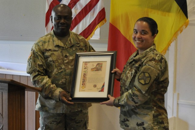 Army Sgt. 1st Class Emmanuel Antwi, Equal Opportunity advisor for U.S. Army Garrison Benelux, poses with Command Sgt. Maj. Samara L. Pitre, command sergeant major for U.S. Army Garrison Benelux, after her speech Oct. 4, 2018, at SHAPE, Belgium.