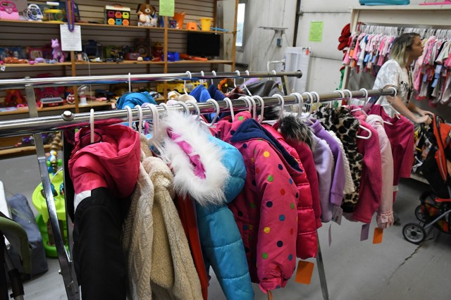 Winter clothing is flying off the racks at the Fort Drum Thrift Shop as community members prepare for the North Country winter. While children's coats were in popular demand, the staff will begin to stock more winter items in the coming weeks. The Thrift Shop is located at Building 1454 on Fourth Street M, off of Ontario Street. It is open from 9:30 a.m. to 2 p.m. Tuesday through Thursday and on the first Saturday of every month. For more information, call (315) 772-7189. (Photo by Mike Strasser, Fort Drum Garrison Public Affairs)