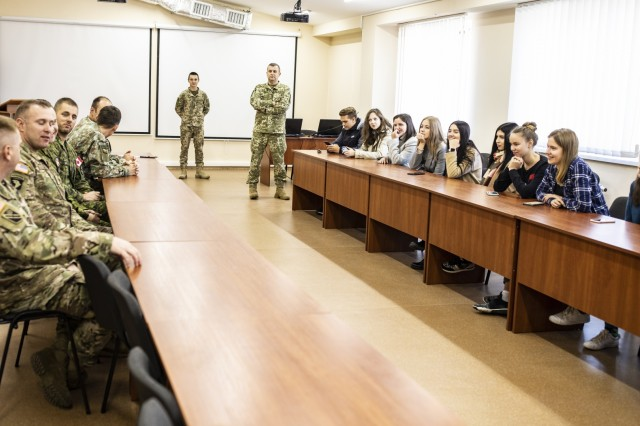 Multinational service members speak with local university students during the students visit at the Yavoriv CTC Sim Centre, Oct. 10.