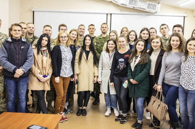 Multinational service members and local university students pose for a picture during the students visit to Yavoriv CTC Sim Centre, Oct. 10.