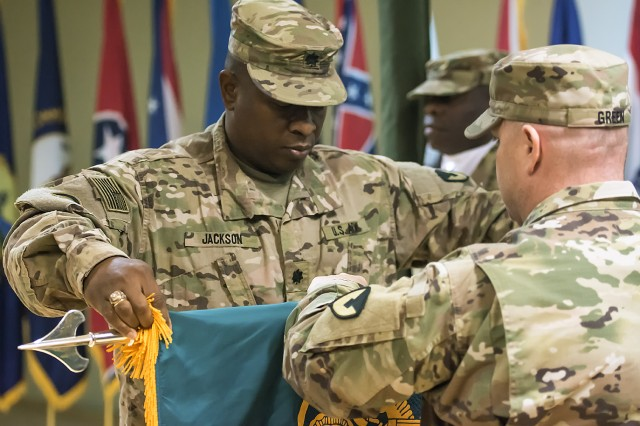 Lt. Col. Torrie Jackson (left), commander, 5th Logistics Civil Augmentation Program Support Battalion and Master Sgt. Douglas Green, senior enlisted advisor, 5th LOGCAP Support Battalion, case their unit colors during a transfer of authority ceremony at Camp Arifjan, Kuwait, Oct. 11. (U.S. Army Photo by Justin Graff, 401st AFSB Public Affairs)