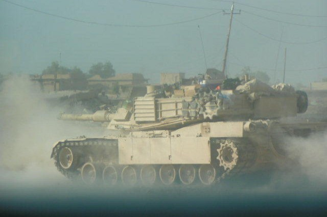 A M1A1 tank fires of Task Force 2-7 fires at suspected enemy locations during the Second Battle of Fallujah, Nov. 2004. (Photo courtesy of Lt. Col. Coley Tyler)