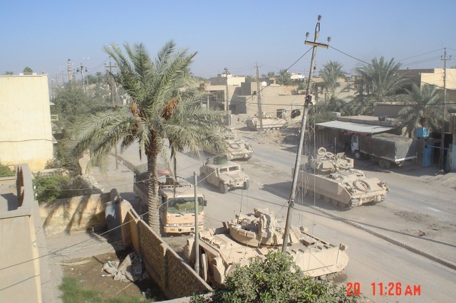 Bradley Fighting Vehicles of Task Force 2-7 during the Second Battle of Fallujah Nov. 2004. (Photo courtesy of Lt. Col. Coley Tyler.)