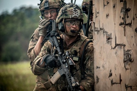 Soldiers assigned to 2nd Infantry Brigade Combat Team, 25th Infantry Division, prepare to clear a building during a combined arms live-fire exercise at Schofield Barracks, Hawaii, Aug. 9, 2018. The exercise is part of an overall training progression in order to maintain combat readiness in preparation for a Joint Readiness Training Center rotation later this year.