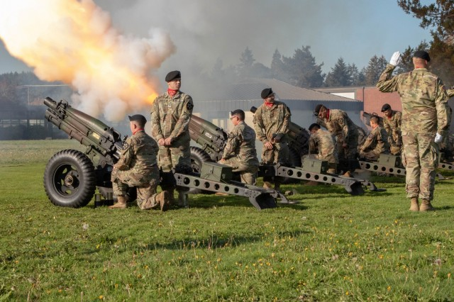 """Soldiers from B Battery, 2nd Battalion, 12th Field Artillery, 2nd Stryker Brigade, 2nd Infantry Division fire rounds during a welcome ceremony for the new Deputy Commanding General of I Corps, Maj. Gen. William H. Graham, Oct. 12, 2018 at Joint Base Lewis-McChord, Washington. """"It's taken me 30 years to get to this storied corps and much desired base,"""" said Graham. """"But it was absolutely worth the wait."""" (U.S. Army photo by Spc. Ethan Valetski, 5th Mobile Public Affairs Detachment.)"""
