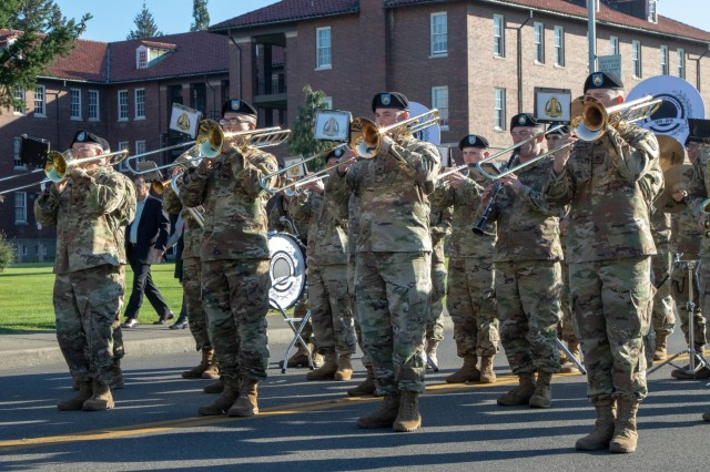 "Soldiers from America's I Corps Band play during a welcome ceremony for the new Deputy Commanding General of I Corps, Maj. Gen. William H. Graham, Oct. 12, 2018 on Joint Base Lewis-McChord. ""It's taken me 30 years to get to this storied corps and much desired base,"" said Graham. ""But it was absolutely worth the wait."" (U.S. Army photo by Spc. Ethan Valetski, 5th Mobile Public Affairs Detachment.)"