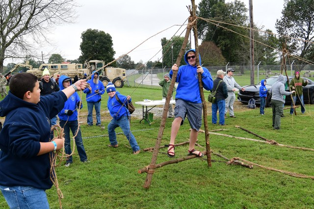 Members of Troop 208, from Morgantown, Kentucky, attempt to perform the A-frame walk at the 2018 Boy Scouts' Patriot Games at Fort Knox Oct. 13, 2018.