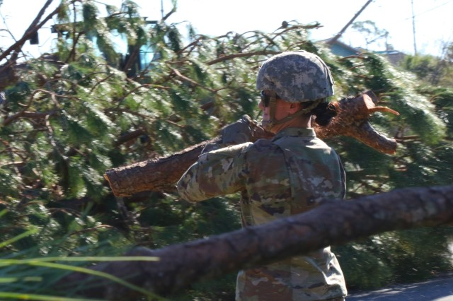 Florida National Guard Pfc. Julia Roberts of the 753rd Brigade Engineer Battalion, Alpha Co. from Tallahassee, Florida, clears the roadway as part of the debris cleanup following Hurricane Michael Oct. 13, 2018, in Panama City, Florida. The Florida National Guard assists communities across Florida as directed by the Governor and the Division of Emergency Management.