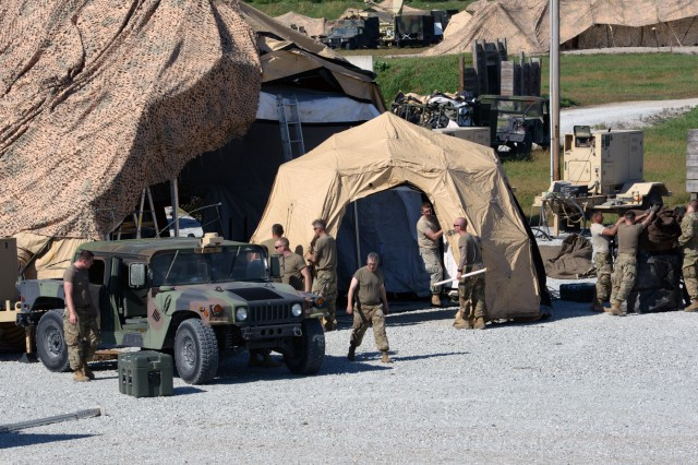 Soldiers with the 38th Infantry Division erect their main command post at Camp Atterbury near Edinburgh, Indiana, during the unit's warfighter exercise, Tuesday, Oct. 9, 2018.