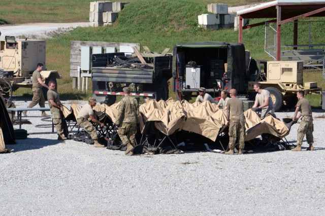Soldiers with the 38th Infantry Division spread a tent at Camp Atterbury near Edinburgh, Indiana, during the unit's warfighter exercise, Tuesday, Oct. 9, 2018.