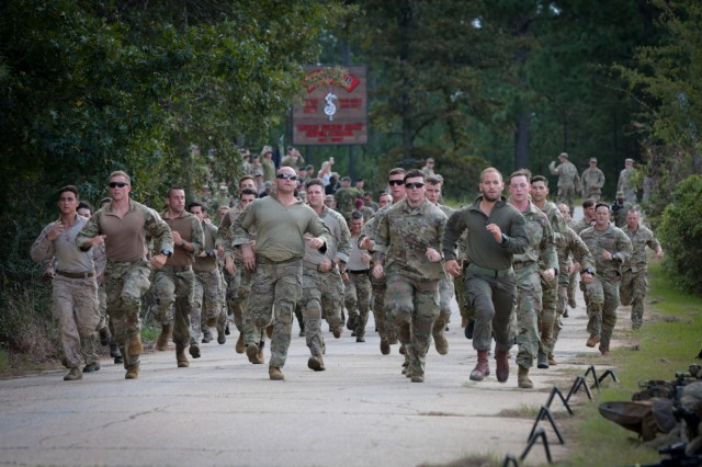 Thirty sniper teams run toward their equipment at the opening of the 18th annual International Sniper Competition, Fort Benning, Ga.