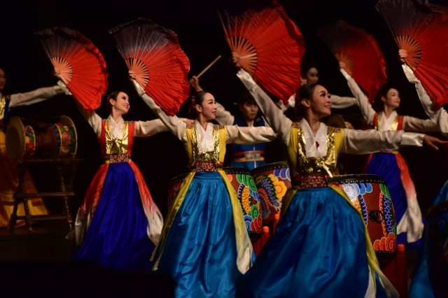 "UIJEONGBU, Republic of Korea -- The Uijeongbu City Dance Team performs a traditional Korean fan dance called ""Buch-chum"" during the Uijeongbu City Friendship and Respect Concert to honor the long-standing partnership at the Arts Center Oct. 15."