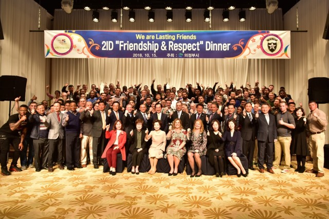 UIJEONGBU, Republic of Korea -- Members of the 2nd Infantry Division/ROK-U.S. Combined Division and local citizens unite at the Uijeongbu City Friendship and Respect Dinner following the concert commemorating the long-standing partnership at the Arts Center Oct. 15.